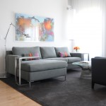Plywood Plank Floor for Contemporary Living Room with Tolomeo Lamp