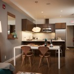 Portico Designs for Modern Kitchen with Brick Wall
