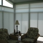 Qmotion Shades for Eclectic Sunroom with Motorized Shades