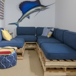 Repurposed Pallets for Beach Style Basement with Blue Cushions