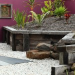 Restaining Wood for Tropical Landscape with Magenta Wall