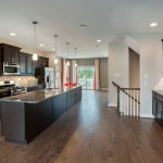 Saddlebrook Estates for Transitional Spaces with Dark Granite Countertops