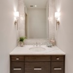 Sibcy Cline Realtors for Beach Style Powder Room with Brown Vanity