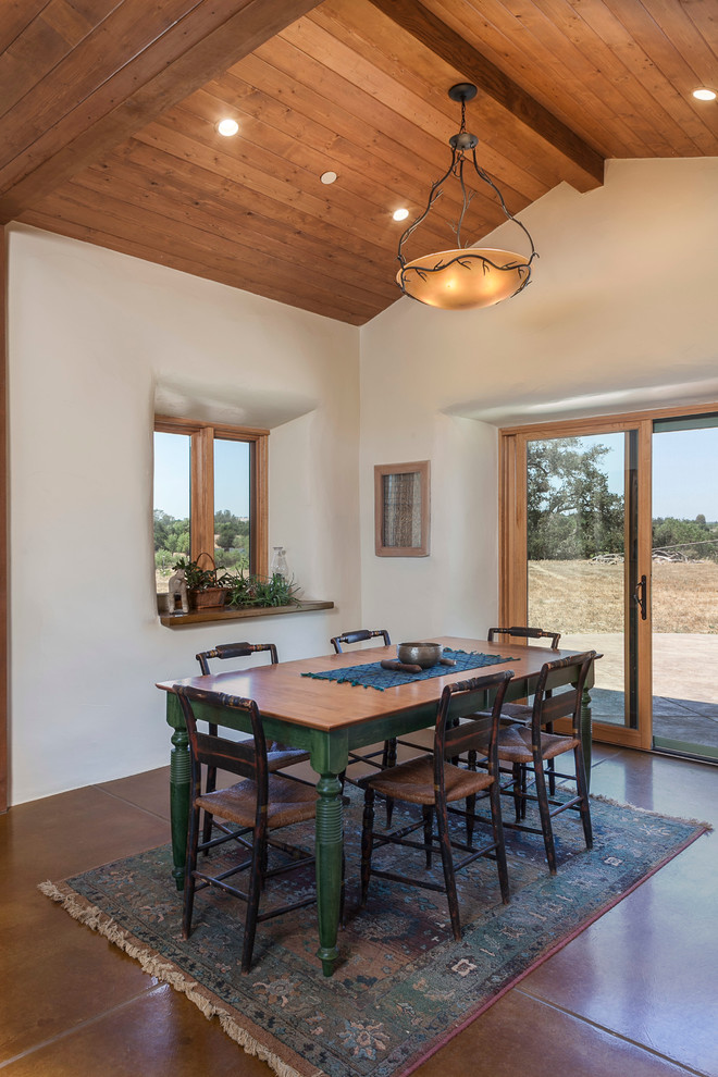 Straw Bale Construction for Farmhouse Dining Room with Brown Tile Floor