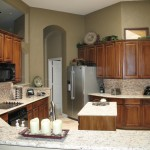 Swenson Granite for Transitional Kitchen with Stained Wood Cabinetry
