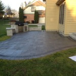 Unilock Pavers for Traditional Patio with Built in Grill