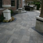 Unilock Pavers for Traditional Patio with Stone Retaining Walls