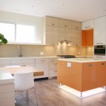 Vinyl vs Laminate for Contemporary Kitchen with Frost Handles